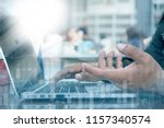 man working on laptop computer... | Shutterstock . vector #1157340574