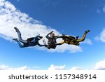 skydiving. two instructors are... | Shutterstock . vector #1157348914