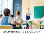 beautiful happy teacher reading ... | Shutterstock . vector #1157386774