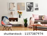 modern chair and sunflowers on... | Shutterstock . vector #1157387974