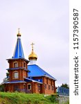 wooden church with domes.... | Shutterstock . vector #1157390587