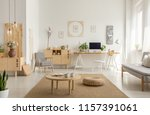 wooden table and pouf on carpet ... | Shutterstock . vector #1157391061