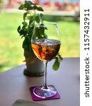one glass of rose wine | Shutterstock . vector #1157432911