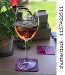 one glass of rose wine | Shutterstock . vector #1157433511