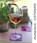 one glass of rose wine | Shutterstock . vector #1157434354