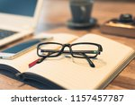 glasses and laptop on the table ... | Shutterstock . vector #1157457787