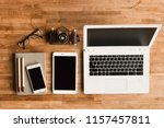 glasses and laptop on the table ... | Shutterstock . vector #1157457811