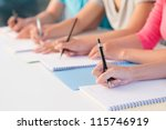 close up of writing hands of... | Shutterstock . vector #115746919