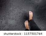 Young Woman's Barefoot Walking...