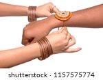 a sister is binding rakhi on... | Shutterstock . vector #1157575774