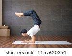 experienced yogi doing scorpion ... | Shutterstock . vector #1157620354