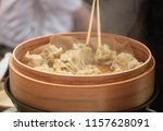 Steamed Korean dumplings Mandu with chicken meat and vegetables in a bamboo steamer