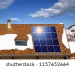 solar panels and snow on a roof. | Shutterstock . vector #1157652664