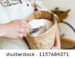 close up of a saleswoman taking ...   Shutterstock . vector #1157684371
