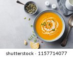 pumpkin and carrot soup with... | Shutterstock . vector #1157714077