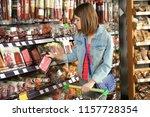 beautiful woman choosing... | Shutterstock . vector #1157728354