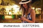 happy woman in floral romper... | Shutterstock . vector #1157729341