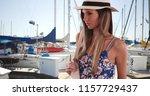 pretty lady in floral romper... | Shutterstock . vector #1157729437