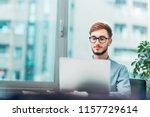 junior researcher working on... | Shutterstock . vector #1157729614
