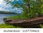 old wooden rowing boat on the... | Shutterstock . vector #1157734621