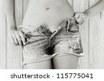 Close up of a woman in jeans texas shorts and pink bikini - stock photo