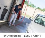 high pressure cleaning the car  | Shutterstock . vector #1157772847