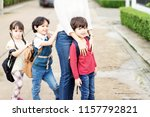 mother and four kids holding... | Shutterstock . vector #1157792821