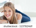 a smiling girl looking at the... | Shutterstock . vector #115782469