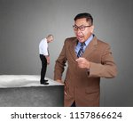 photo collage. angry asian... | Shutterstock . vector #1157866624