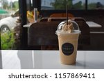 iced caramel macchiato on the... | Shutterstock . vector #1157869411