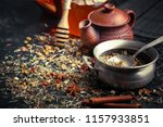 dry tea leaves in a spoon on an ... | Shutterstock . vector #1157933851
