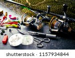 fishing rods and spinnings in... | Shutterstock . vector #1157934844