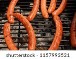 delicious grilled sausages | Shutterstock . vector #1157993521