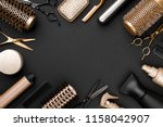 Hairdresser tools on black background with copy space in center