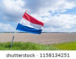 waving dutch flag in a typical... | Shutterstock . vector #1158134251