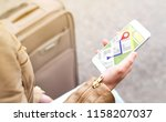 tourist using map in phone app... | Shutterstock . vector #1158207037