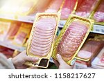 woman chooses a slice of ham... | Shutterstock . vector #1158217627
