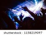 cheering crowd at concert... | Shutterstock . vector #1158219097