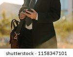 mid section of a man in formal... | Shutterstock . vector #1158347101