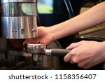 barista grinding coffee beans... | Shutterstock . vector #1158356407