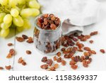 a bunch of grapes raisins on a... | Shutterstock . vector #1158369337