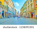 Small photo of KRAKOW, POLAND - JUNE 11, 2018: Florianska Street in one of the main streets in old town with historical edifices and tourist attractions, on June 11 in Krakow