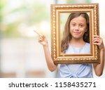 brunette hispanic girl holding... | Shutterstock . vector #1158435271