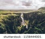 icelandic green hills and... | Shutterstock . vector #1158444001