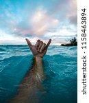 Man's Arm Underwater With Hand...