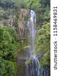 Tall Tropical Waterfall On The...