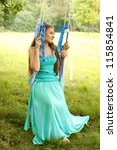 Portrait of a woman on a swing with ribbons - stock photo