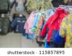 Winter jackets and accessories on stands in kids mall - stock photo