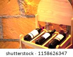 wine bottles on shelf in...   Shutterstock . vector #1158626347