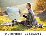 Young Artist Painting An Autumn ...